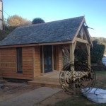 Delabole Slate Roof and Larch Timber Cladding on New Self Build Summerhouse in Devon by Carpenter Oak Ltd