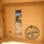 Oak Timber Framed Glazing with Painted Cladding on New Build Oak Framed Summerhouse in Devon by Carpenter Oak Ltd