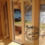 Glazed Doors Detail with River View in Oak Timber Frame New Build Summerhouse in Devon