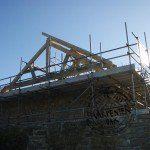 an oak framed vaulted roof being built