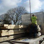 A lorry load of oak beams for a new oak framed house