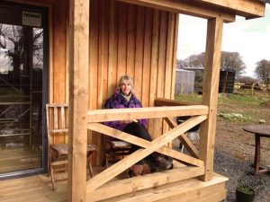 Vickie Ward Outside her Carpenter Oak Timber Framed Eco Cabin