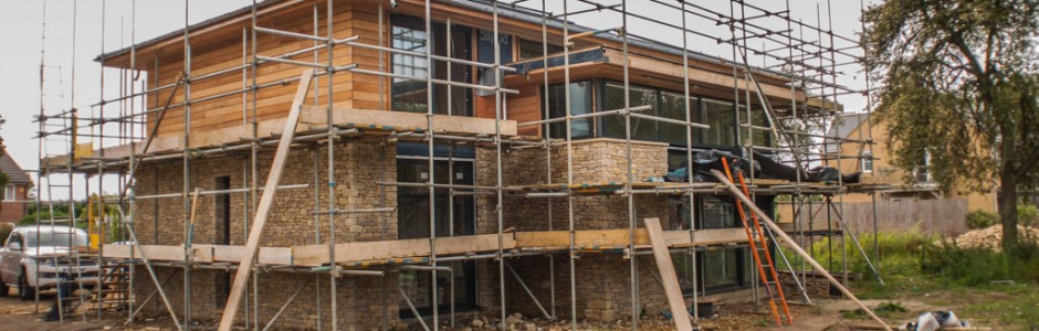 contemporary oak frame stone wall cedar cladding exterior