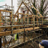 Side elveation view of a self build oak frame with scaffolding