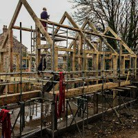 posts, crossbeams and roof gables of a new self build oak frame
