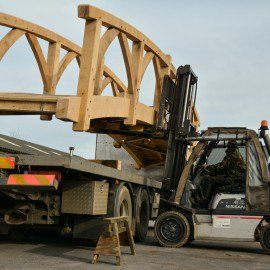 long shot of oak garden bridge being moved with a forklift truck