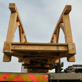 looking up at oak garden bridge being moved with a forklift truck