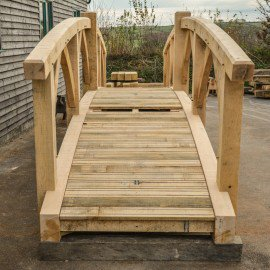 Front view of a new oak garden bridge