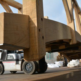 close up of oak garden bridge being moved with a forklift truck