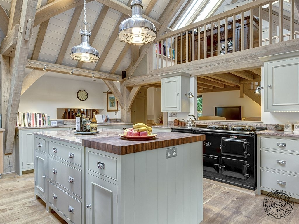 Kitchen Interior with Mezzanine Gallery in Oak Frame Extension on House in Dartmouth Devon by Carpenter Oak Ltd Devon
