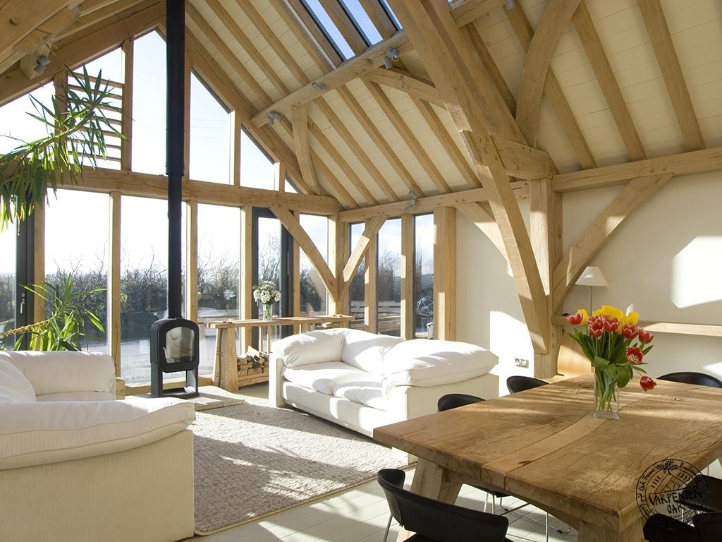 Interior of Green Oak Frame Show Barn with Woodburner and Glazed Gable End