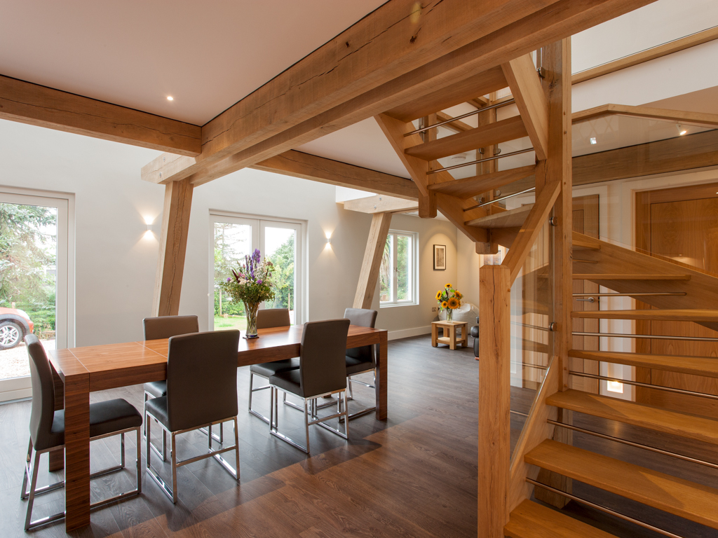 Oak framed living area - timber frame houses by Carpenter Oak Ltd