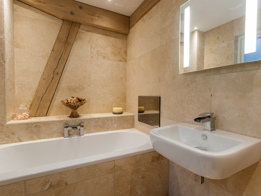 Oak framed bathroom - timber frame houses by Carpenter Oak Ltd