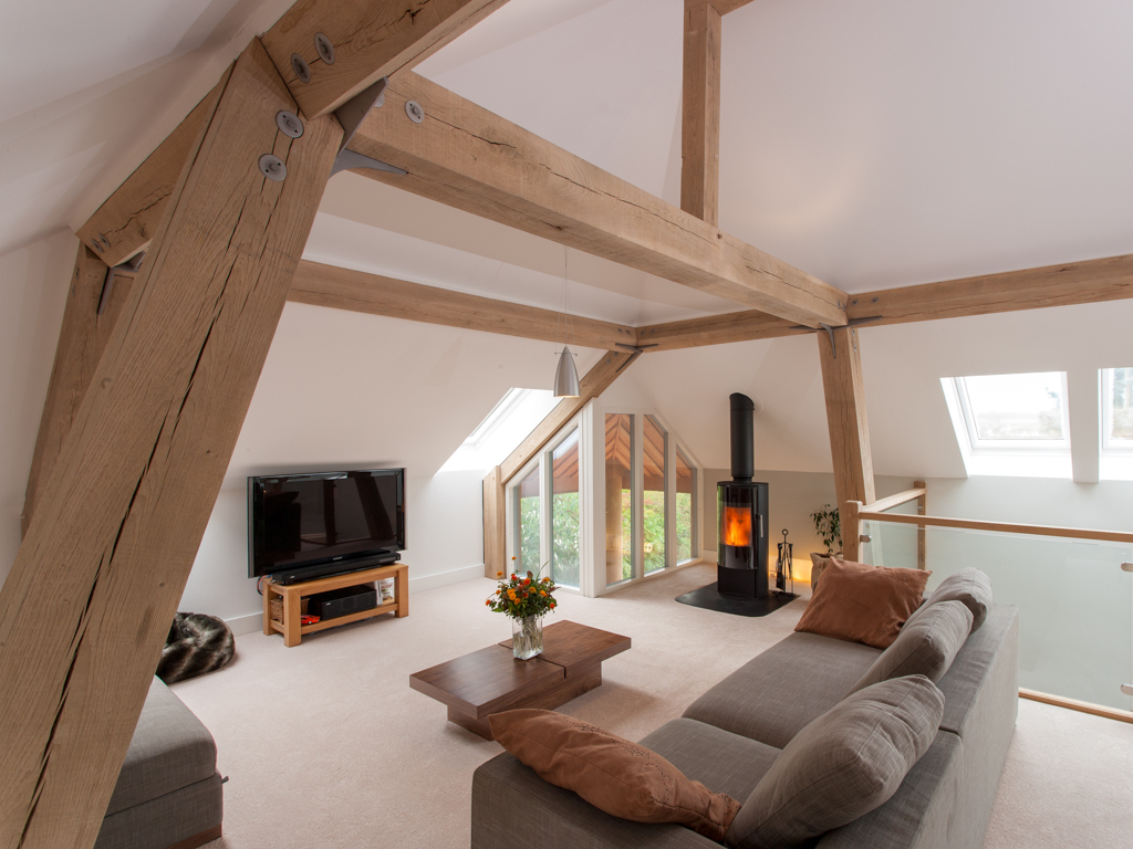 Timber frame houses by Carpenter Oak Ltd