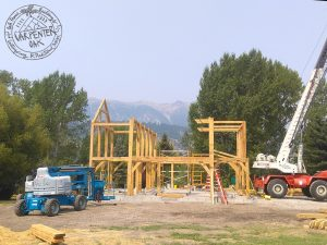 Side view of an oak frame being built