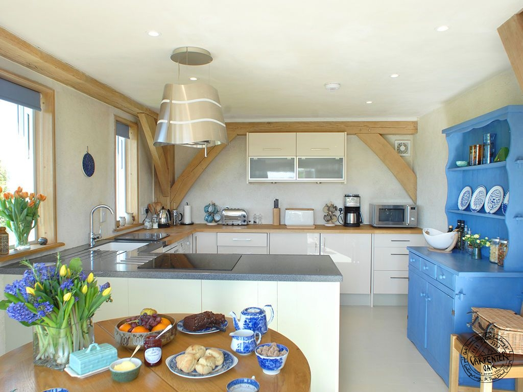 Contemporary Kitchen Interior of Green Oak Framed New Build House in Cornwall by Carpenter Oak Ltd Devon