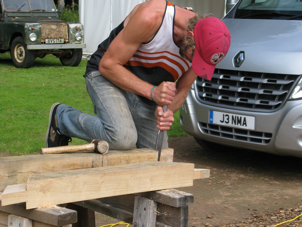 Carpenter Using Chisel On Oak Frame Demonstration