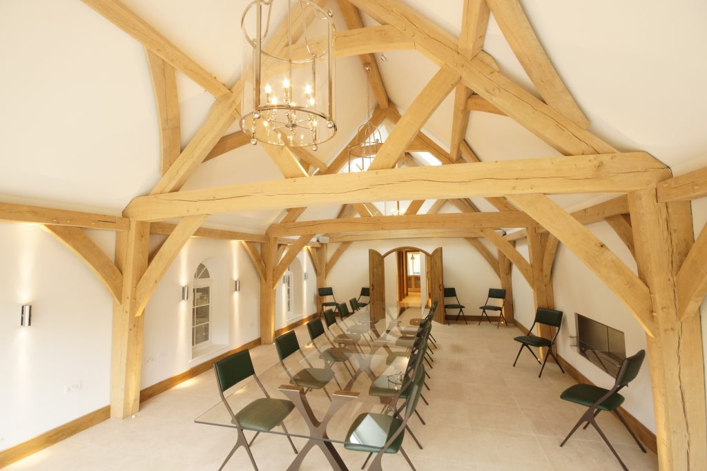 The interior view of the Hundred Hills Winery boardroom with exposed oak frame